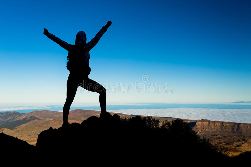 Woman hiking success silhouette, business concept royalty free stock image