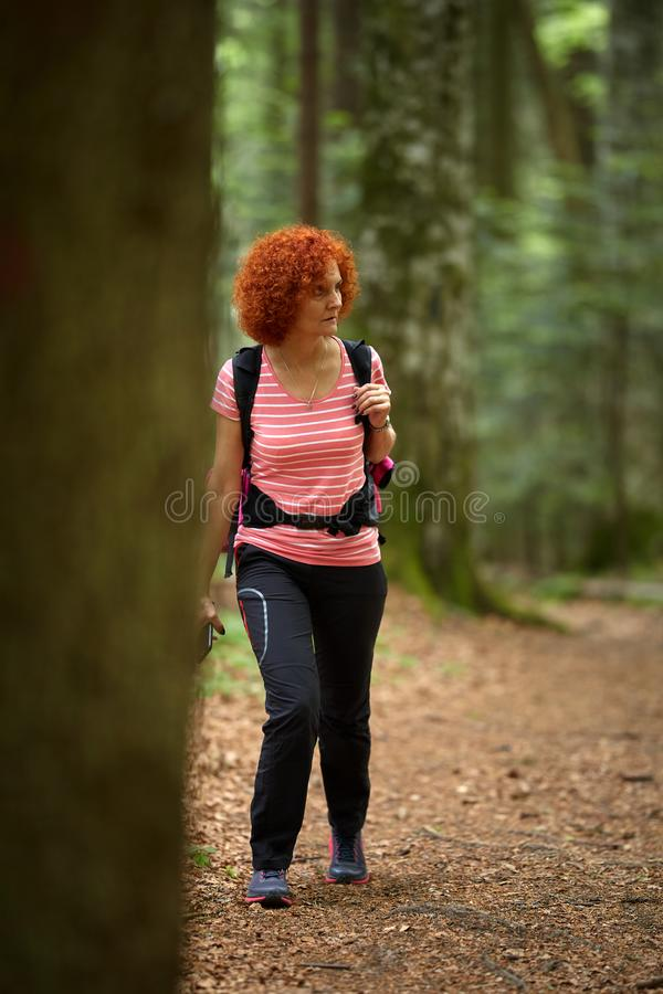 Woman hiking on a trail stock photography