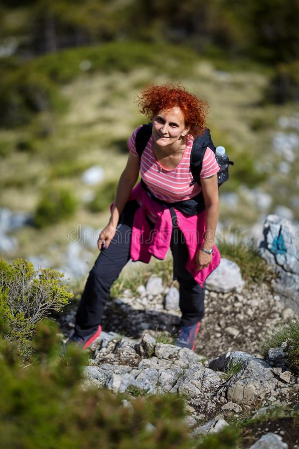 Woman hiking on a trail stock photos
