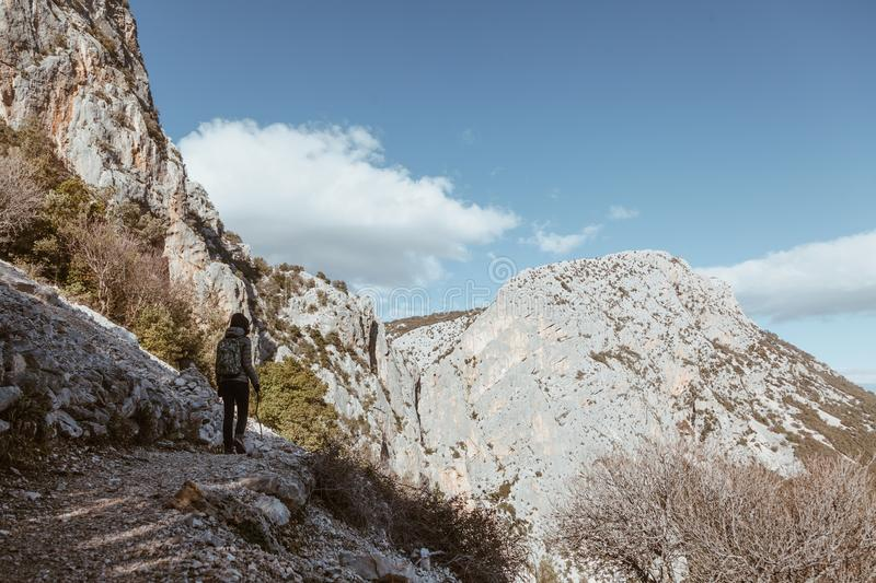 Woman hiking in the trail to Gola su gorroppu - activity and health concept.  royalty free stock photo