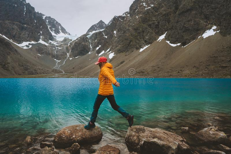 Woman hiking travel in Norway mountains with blue lake view stock photos