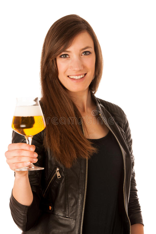 Woman hilding glass of beer in her hands royalty free stock photos