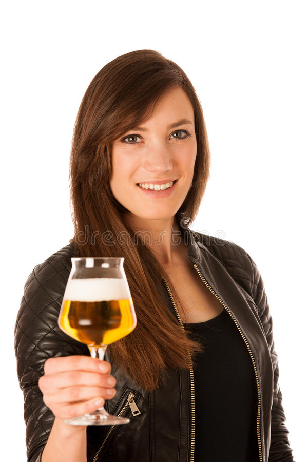 Woman hilding glass of beer in her hands royalty free stock photo