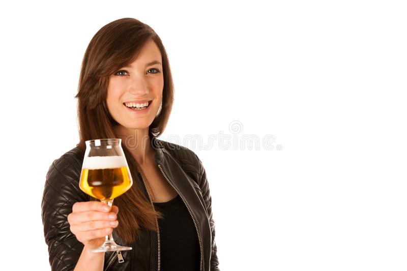Woman hilding glass of beer in her hands royalty free stock image