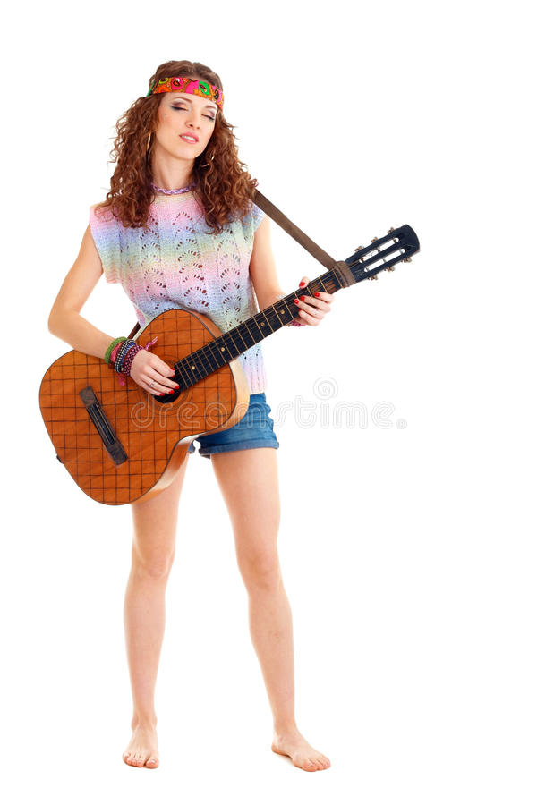 Woman In Hippie Outfit Playing On Guitar Stock Photo