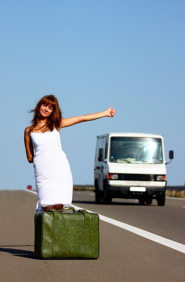 Woman hitchhiking stock photos