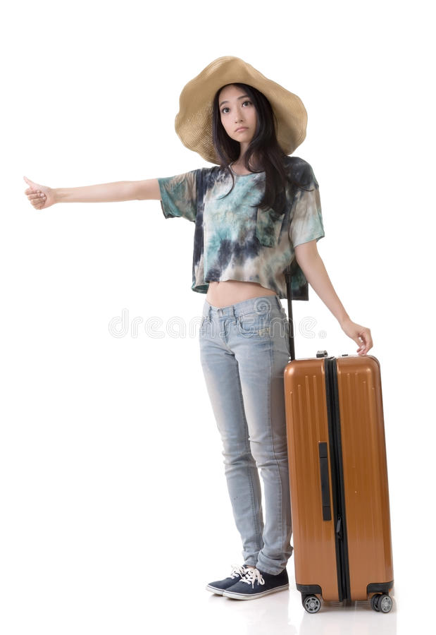 Woman hitchhiking. Asian young traveling woman hitchhiking, full length portrait isolated on white stock photo