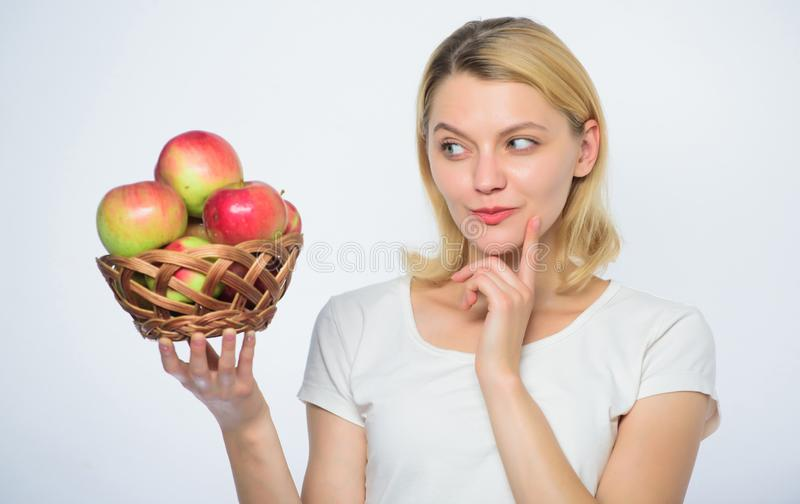 Woman hold apples. Baking apple pie. Delicious recipes. Come up with idea to cook. Girl live healthy life. Apple organic royalty free stock image
