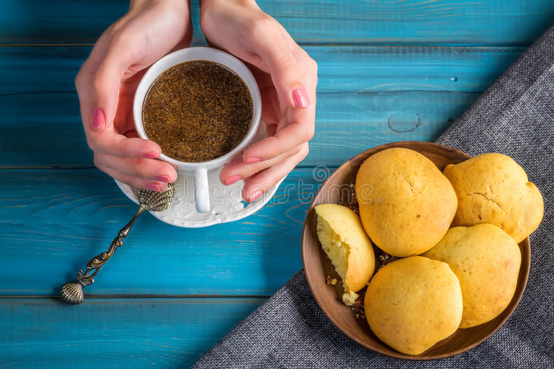 Woman Hold Coffee in vintage mug in hands with grunge spoon and stock photography