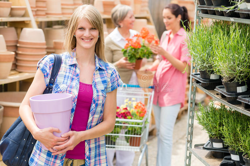 Download Woman Hold Flower Pot Garden Centre Store Royalty Free Stock Photography - Image: 26143197