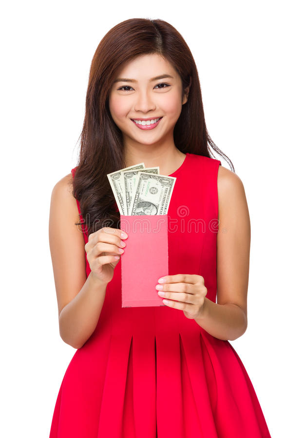 Woman hold red pocket with USD stock images