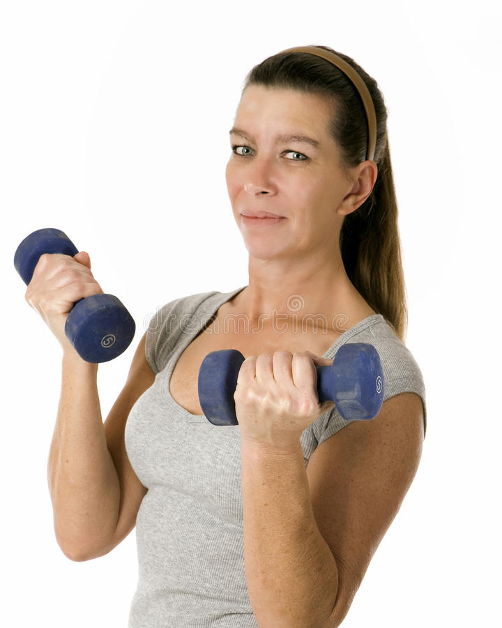 Woman holding 5 pound weights royalty free stock image