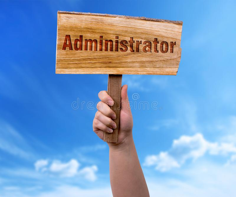Administrator wooden sign. A woman holding administrator wooden sign on blue sky background royalty free stock photo