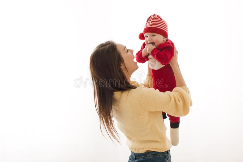 Woman holding adorable toddler in holiday suit royalty free stock photography