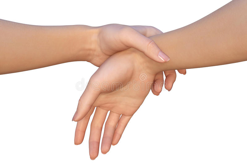Woman is holding another female by the wrist of her hand. A closeup of a female hands that are touching each other very gently. A woman is holding a wrist of royalty free stock photos