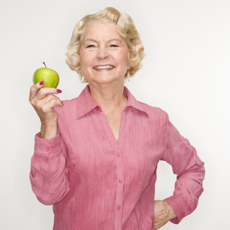 Woman holding apple. royalty free stock photography