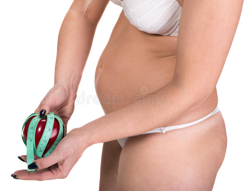 Woman holding apple and centimeter stock images