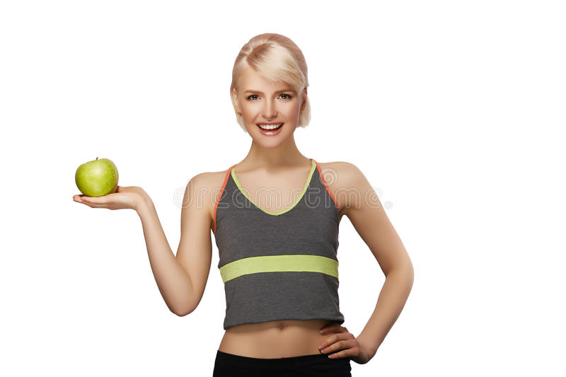 Woman holding apple. Happy smiling slim woman holding green apple, studio portrait isolated on white background, healthy lifestyle concept stock images
