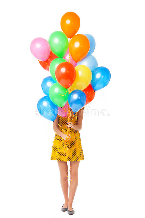 Download Woman holding balloons stock image. Image of covered - 27169759