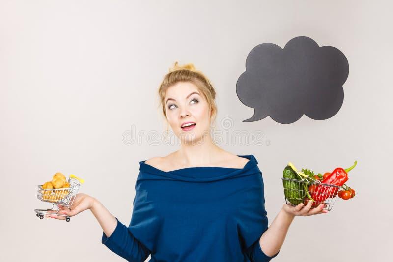 Woman holding basket with fruits and sweet bun stock photos