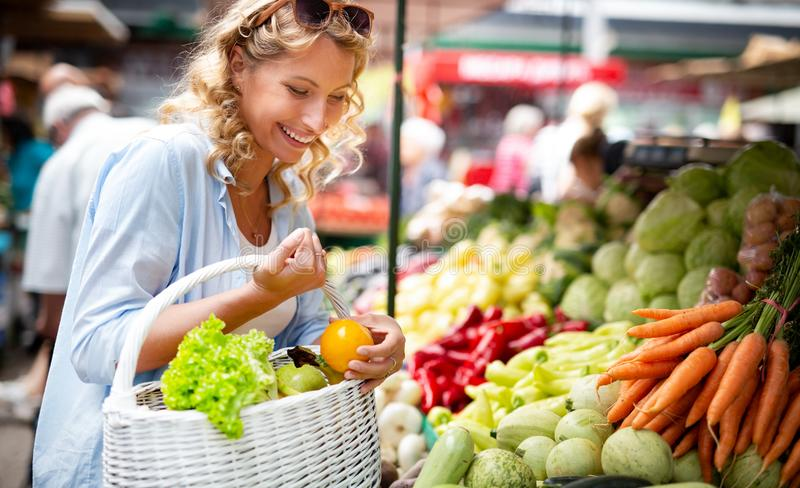 Woman holding a basket with healthy organic vegetables. Woman holding a basket with healthy fresh organic vegetables royalty free stock photography