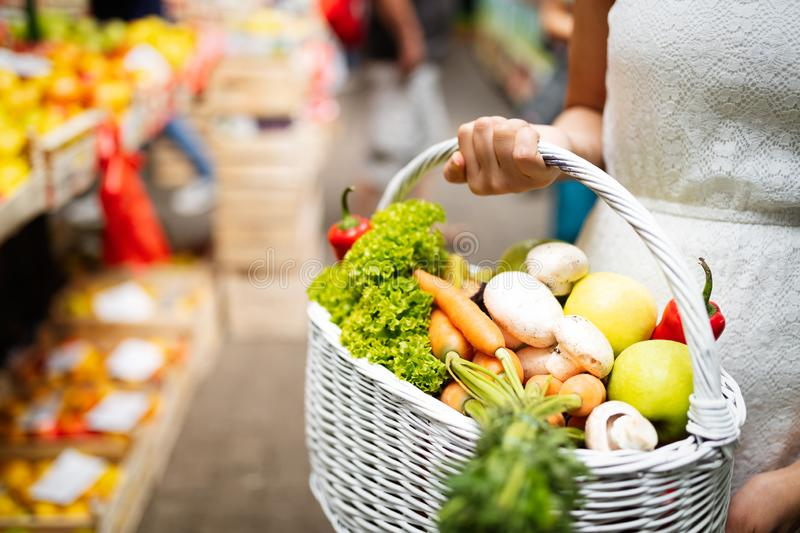 Woman holding a basket with healthy organic vegetables. Woman holding a basket with healthy fresh organic vegetables stock image