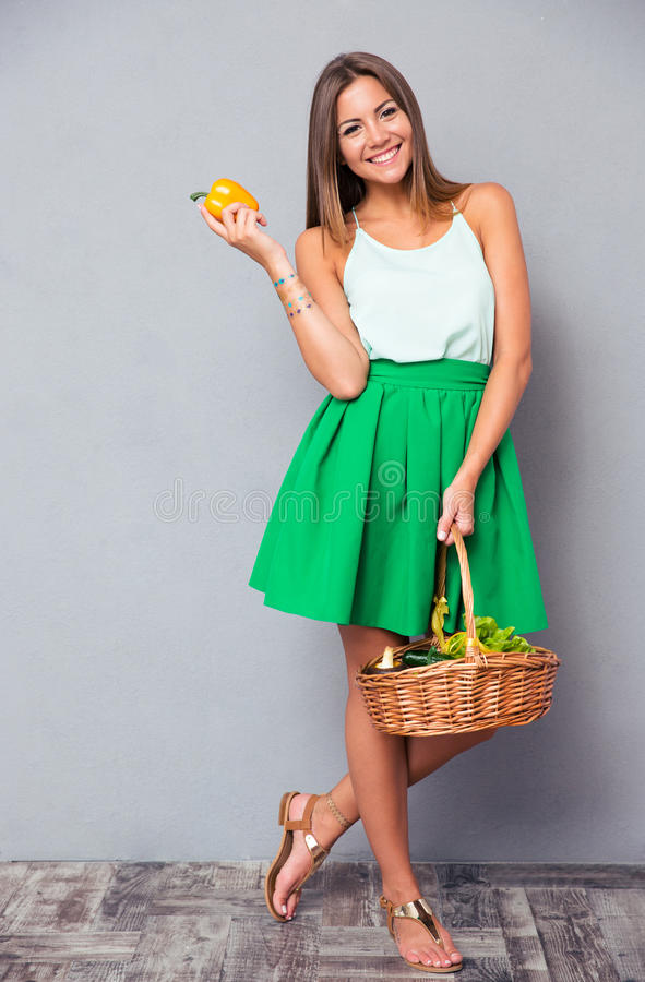 Woman holding basket with vegetables stock image