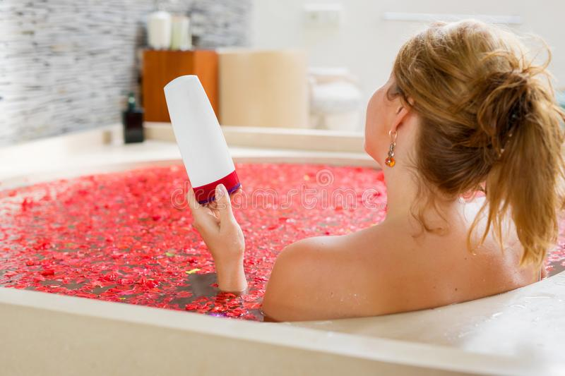 Woman holding bathing product in hand royalty free stock images