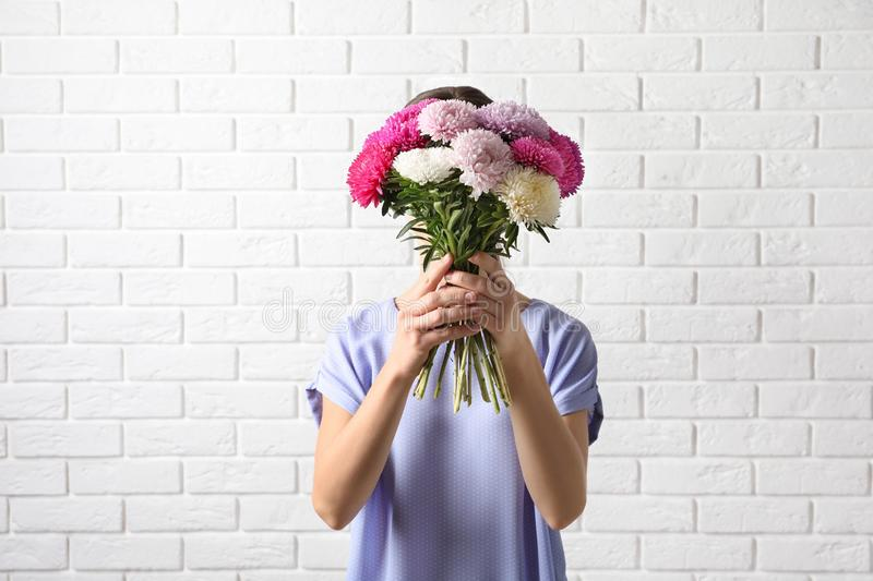 Woman holding beautiful aster flower bouquet royalty free stock photos