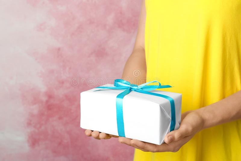Woman holding beautifully wrapped gift box royalty free stock photos