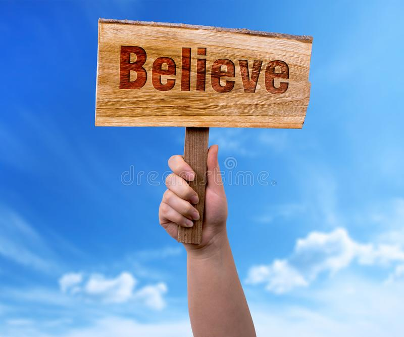 Believe wooden sign stock image