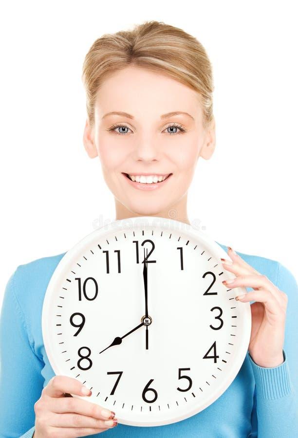 Woman holding big clock royalty free stock image