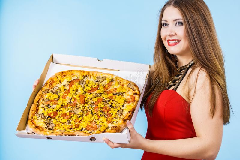 Woman holding big pizza in box stock images
