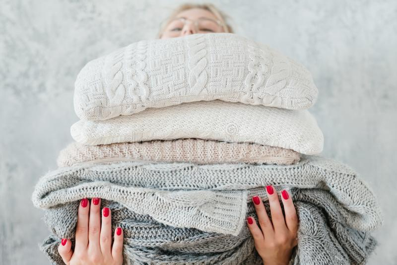 Woman knitted plaid blanket cozy winter home decor royalty free stock photography
