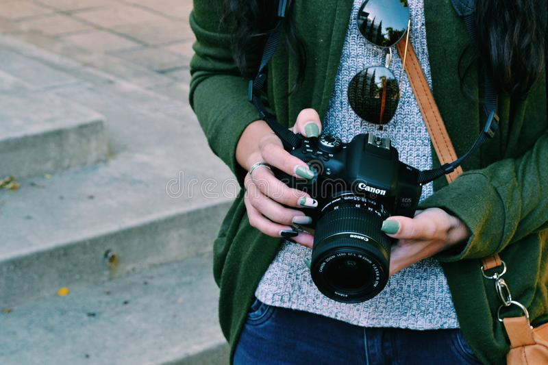 Woman Holding Black Canon Dslr Camera royalty free stock images