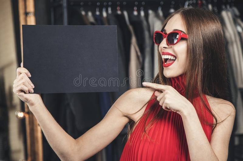Woman Holding Black Card royalty free stock photo