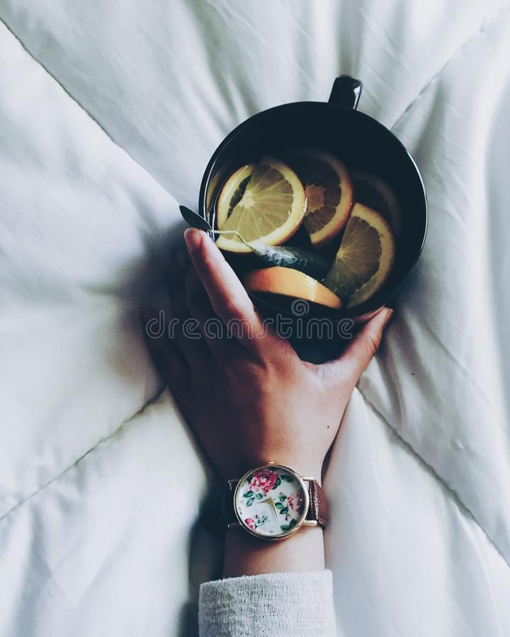 Woman Holding Black Ceramic Mug With Sliced Lemon On Top Of White Bed Comforter Free Public Domain Cc0 Image