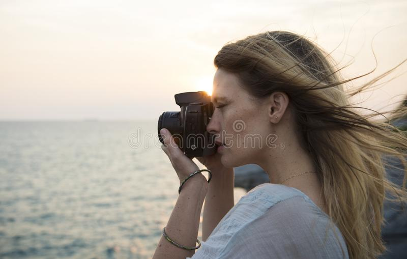 Woman Holding Black Dslr Camera royalty free stock photography