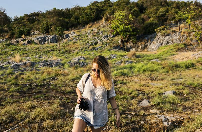 Woman Holding Black Dslr Camera Near Forest stock image