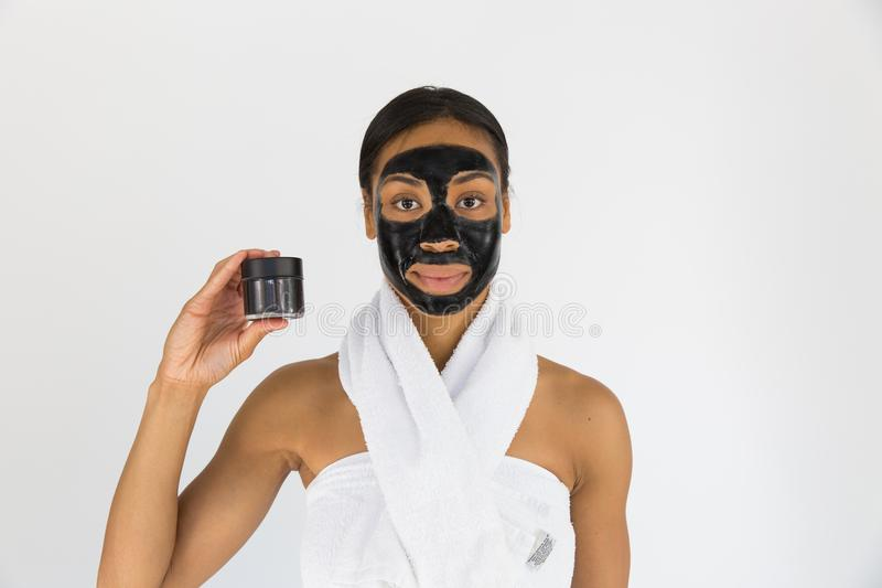 Woman Holding Black Mask royalty free stock photography