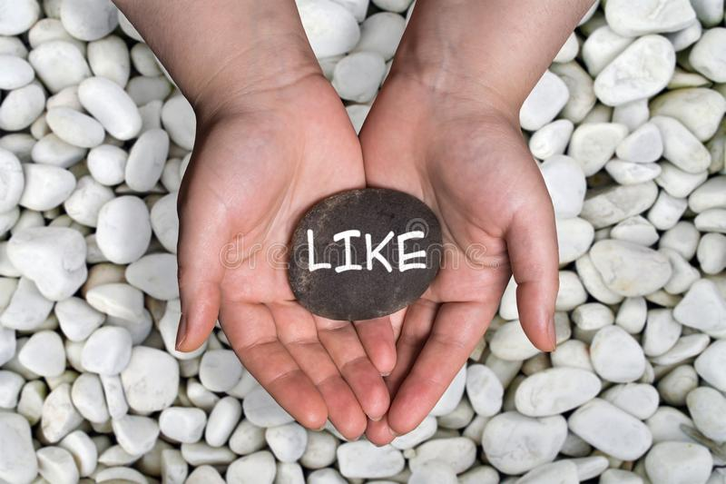 Like word in stone on hand stock photos