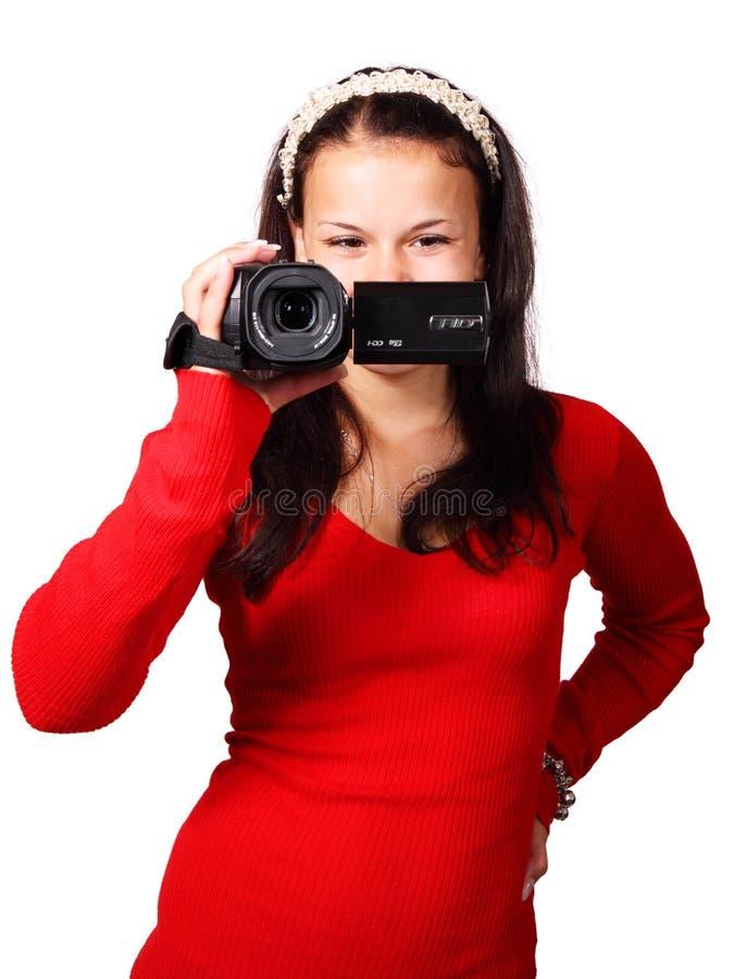 Woman Holding a Black Video Camera stock photo