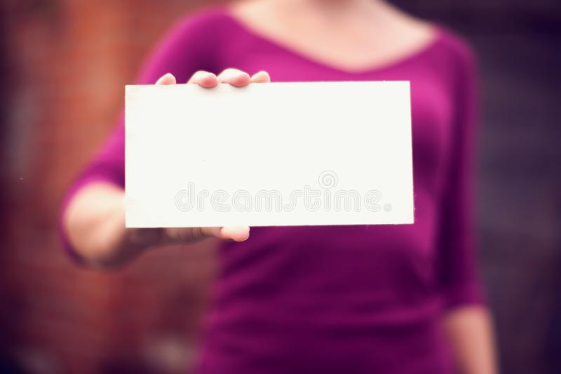Woman holding a blank billboard with copy space-advertisement co stock photos
