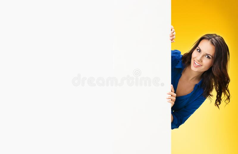 Woman holding blank billboard with copy space royalty free stock images
