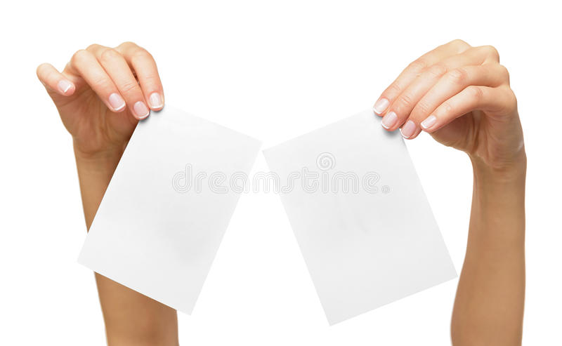 Woman holding blank business card in hand. Isolated on white royalty free stock photo