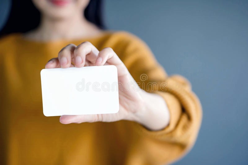 Woman holding blank business card. For mock up royalty free stock images
