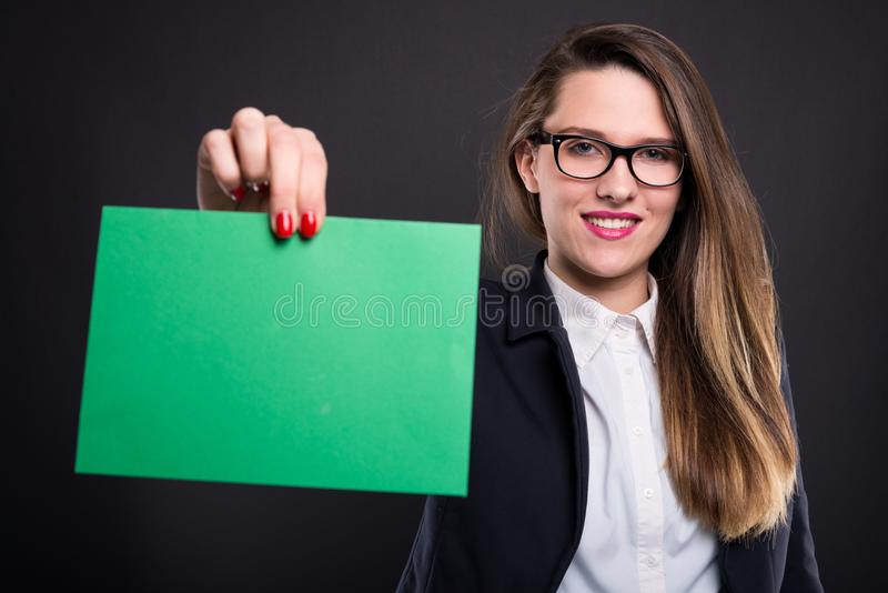 Woman holding blank paper with copyspace stock image