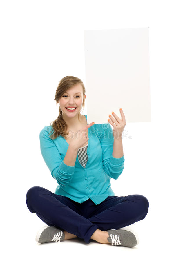 Woman holding blank poster stock photography