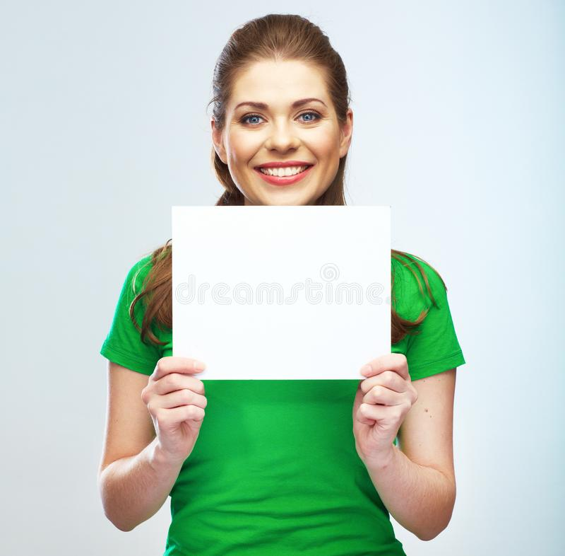 Woman holding blank poster isolated portrait. Woman holding blank poster isolated studio portrait royalty free stock photos