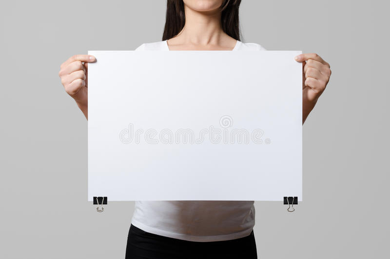 Woman holding a blank poster. royalty free stock photography